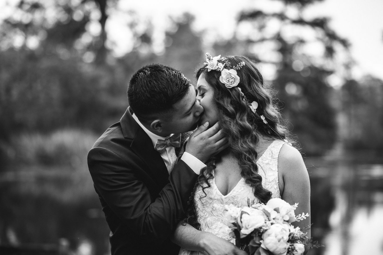 black and white portrait of couple kissing
