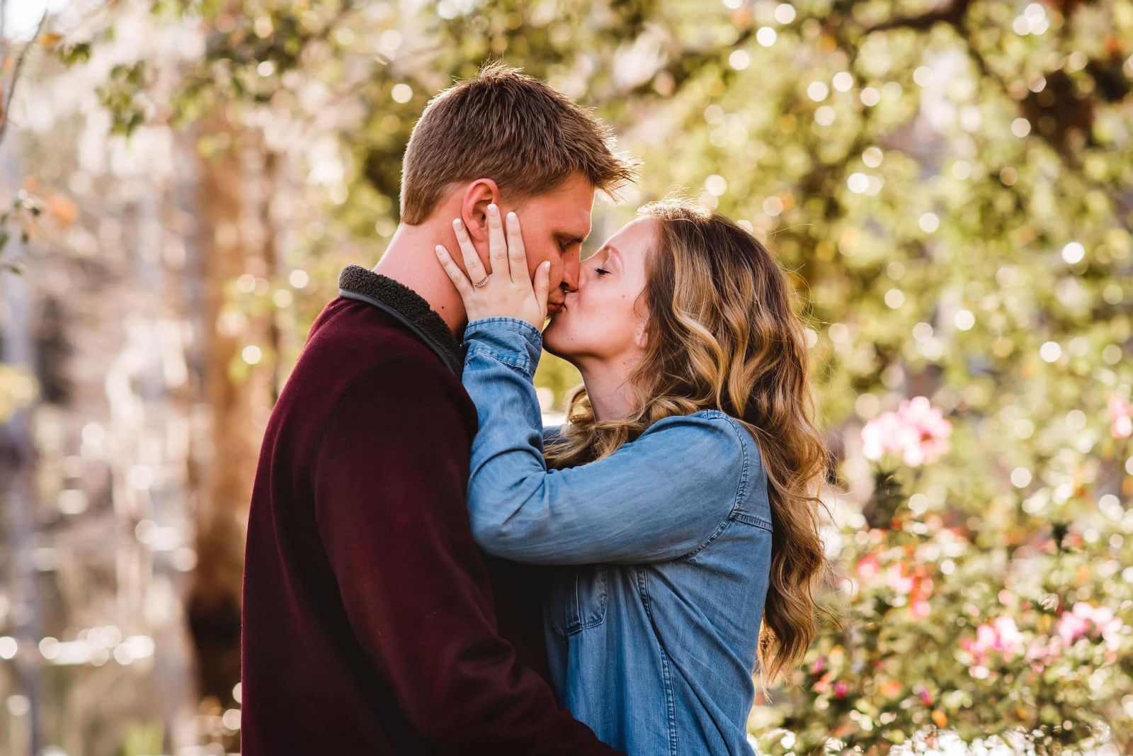 portrait of couple kissing in cypress gardens sc