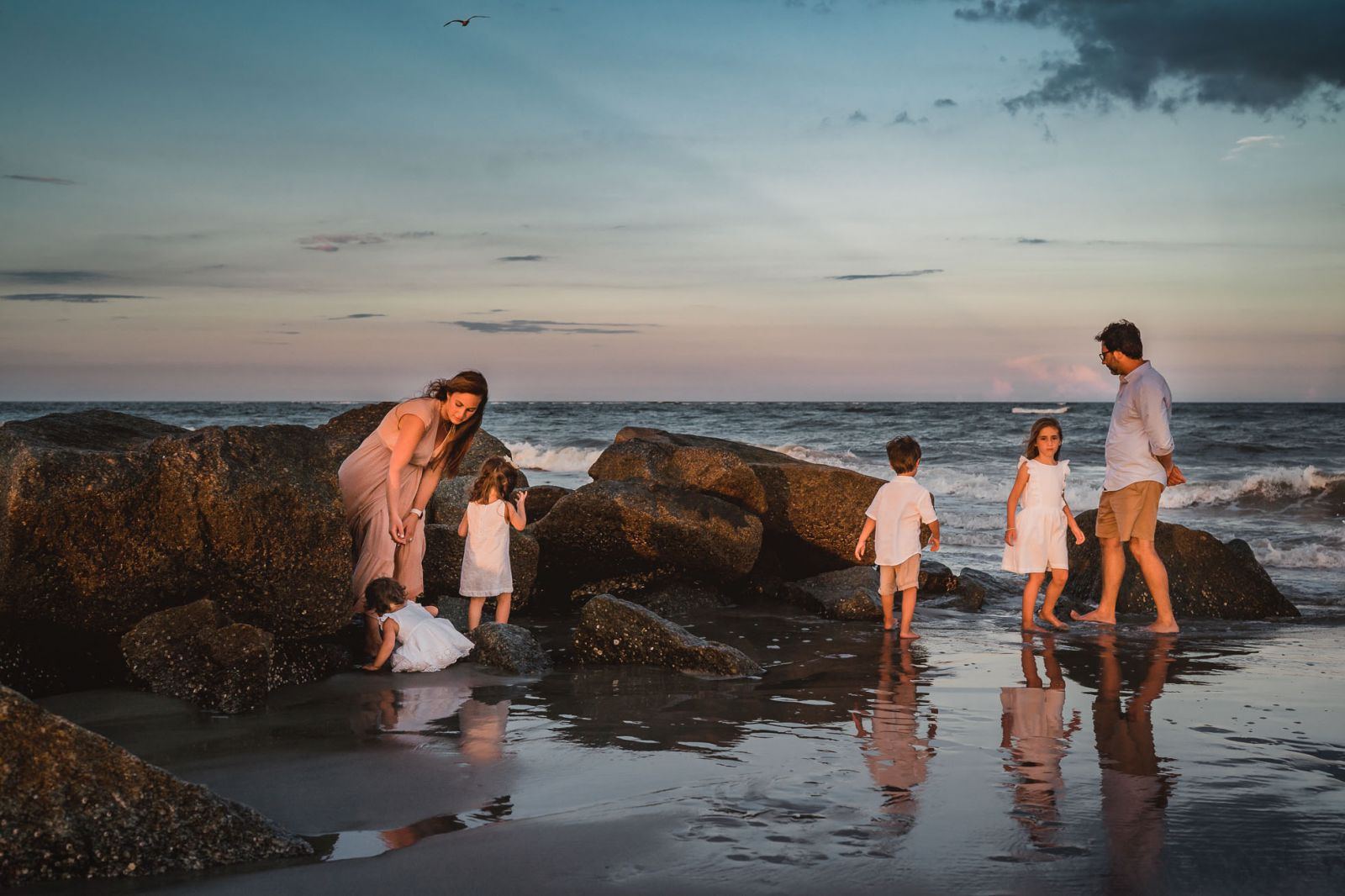 portrait of family exploring folly beach