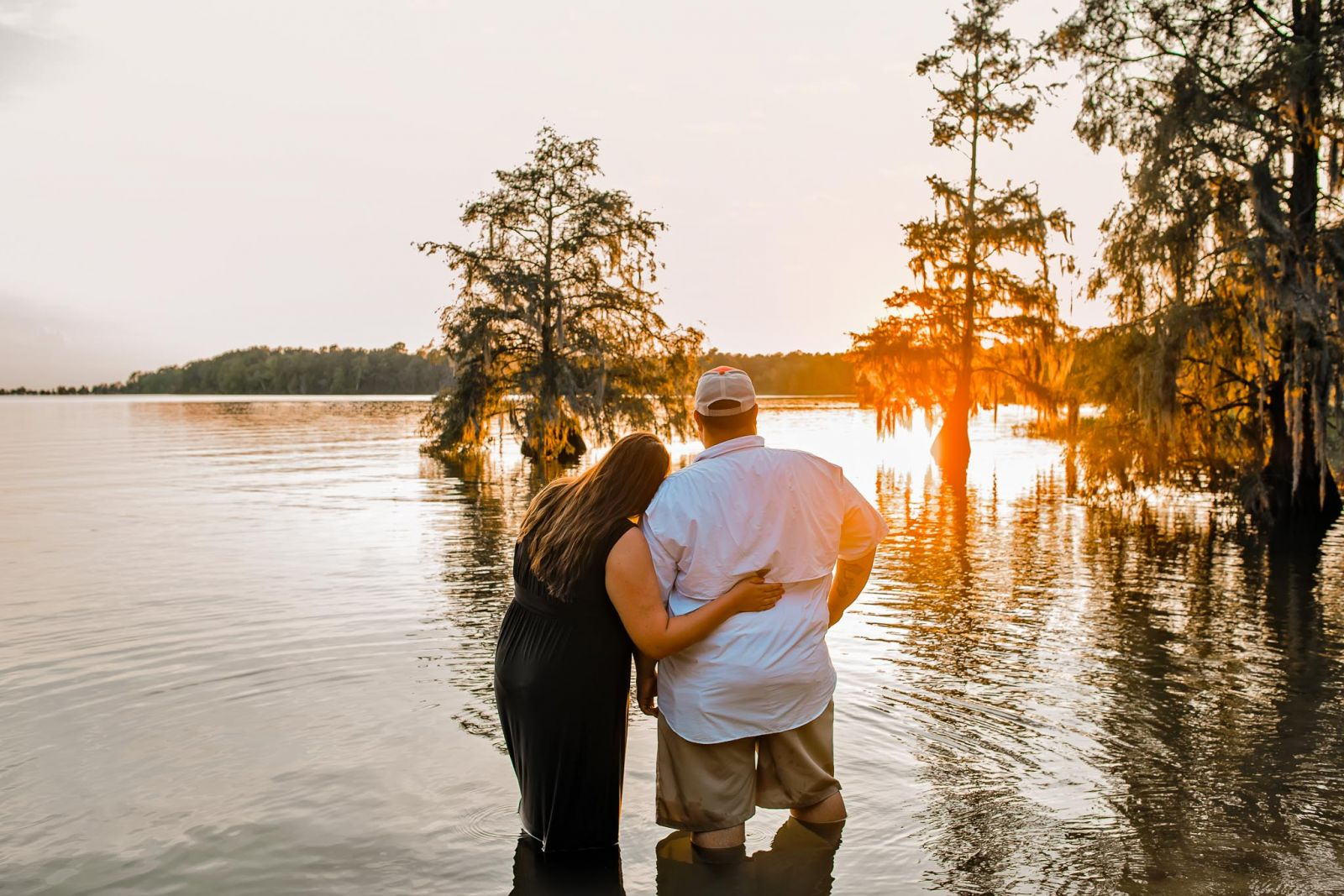 sunset portrait of couple hugging in cypress lake SC
